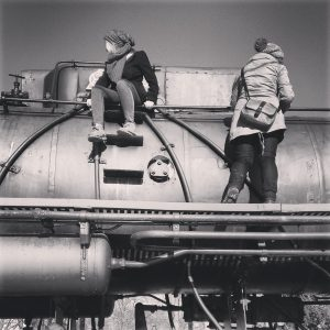 Hipsters seen here nesting in their natural habitat, an abandoned locomotive.